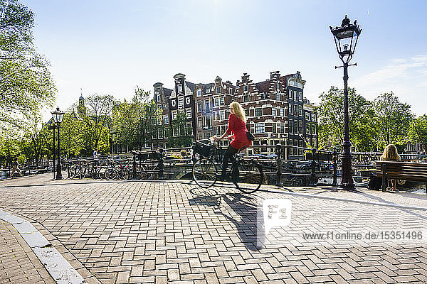 Cyclists on a bridge over Brouwersgracht  Amsterdam  North Holland  The Netherlands  Europe