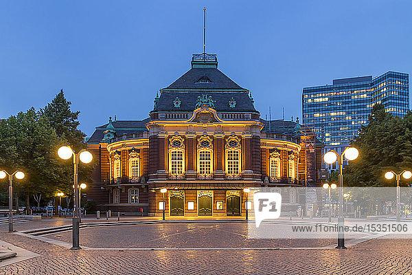 The illuminated Laeiszhalle concert hall at Johannes Brahms Square during dusk  Hamburg  Germany  Europe