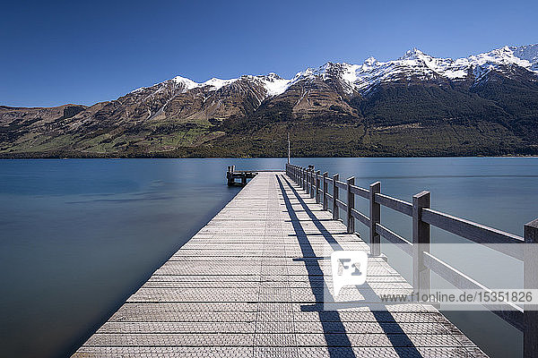 Wooden jetty leading into turquoise Lake Wakitipu  Queenstown  Otago  South Island  New Zealand  Pacific