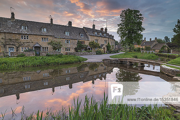 Colourful sunrise above the pretty village of Lower Slaughter in the Cotswolds  Gloucestershire  England  United Kingdom  Europe