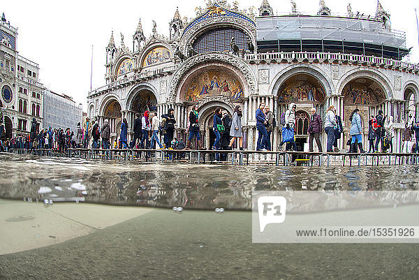St. Mark's Square and Basilica flooded by high tide  Venice  UNESCO World Heritage Site  Veneto  Italy  Europe