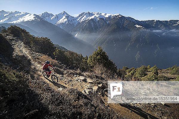 Mountain biking along a Enduro style single track trail in the Nepal Himalayas near the Langtang region  Nepal  Asia