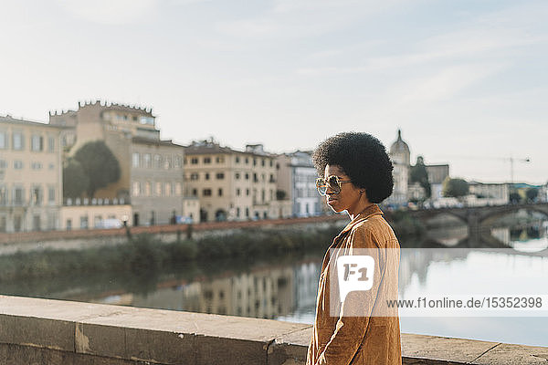 Young woman with afro hair crossing bridge  Florence  Toscana  Italy