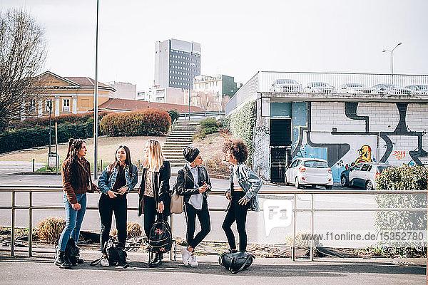 Friends talking in street  Milan  Italy
