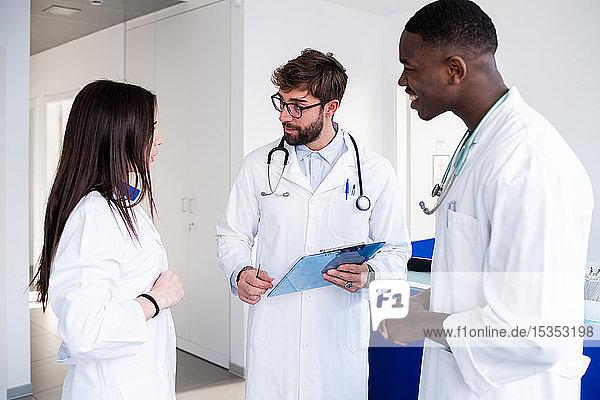 Doctors talking at hospital reception
