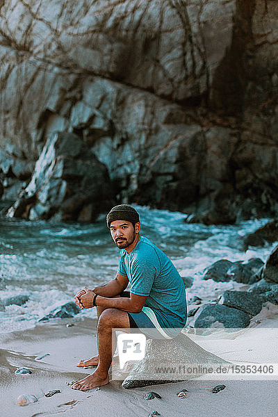 Man relaxing on beach  Big Sur  California  United States