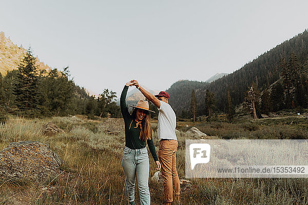 Young couple dancing together in rural valley  Mineral King  California  USA