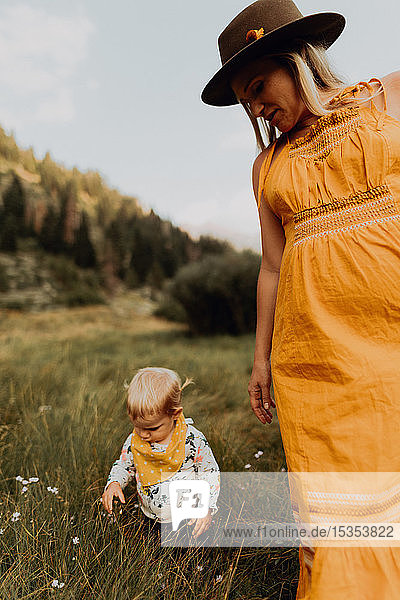Pregnant mother with toddler daughter in rural valley  Mineral King  California  USA