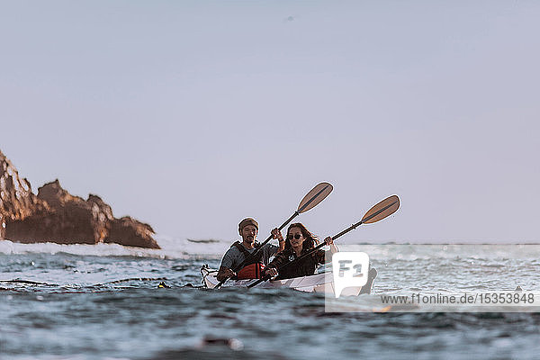 Friends kayaking in sea  Big Sur  California  United States