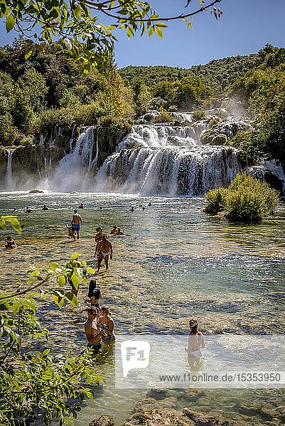People swimming in the Krka River at the Krka waterfalls  Krka National Park; Croatia