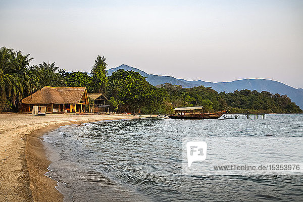 Boat moored to dock in front of Mbali Mballi Mahale Lodge (Kungwe Beach Lodge) in Mahale Mountains National Park on the shores of Lake Tanganyika  Tanzania