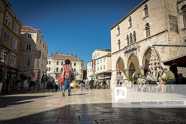 Tourists mix with locals in Nardoni Trg or National Place in the Old City; Split  Croatia