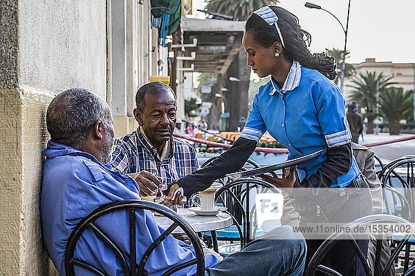 Eritrean men having coffee at the Impero café; Asmara  Central Region  Eritrea