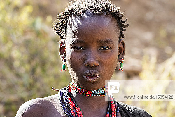 Hamer woman at a bull jumping ceremony  which initiates a boy into manhood  in the village of Asile; Omo Valley  Ethiopia