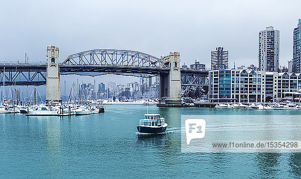 Burrard Street Bridge and a view of Granville Island with boats in False Creek; Vancouver  British Columbia  Canada