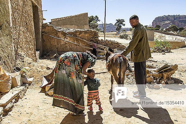 Ethiopian family and their donkey; Dugem  Tigray Region  Ethiopia