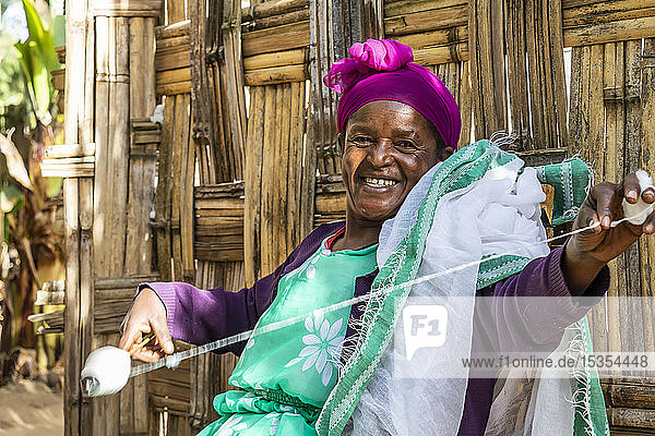 Dorze woman spinning cotton  Dorze village; Southern Nations Nationalities and Peoples' Region  Ethiopia