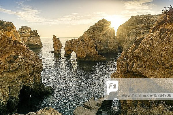 Rugged rocky coast  cliffs and arches in Ponta da Piedade at sunrise  Lagos  Algarve  Portugal  Europe