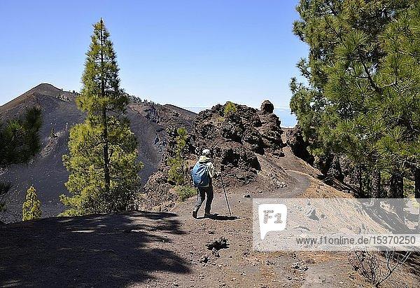Female hiker in front of volcano Duraznero  volcanic landscape  Ruta de los Volcanes  Cumbre Vieja nature park Park  La Palma  Canary Islands  Canary Islands  Spain  Europe