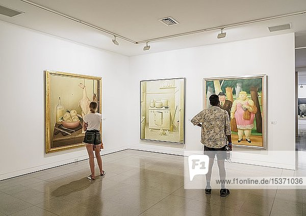 Museum visitors looking at paintings by Fernando Botero  Museum of Antioquia  interior  Medellin  Antioquia Department  Colombia  South America
