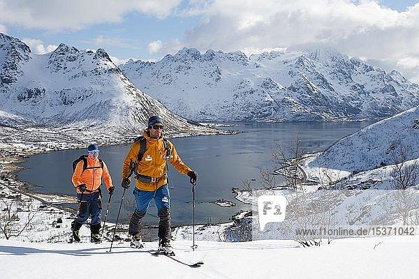 Ski mountaineers on tour to Pilan  Hinter Fjord  Austvågøy  Lofoten  Norway  Europe