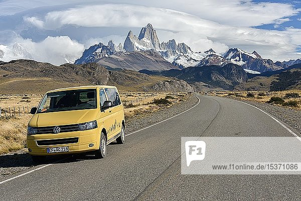 VW bus on the road to El Chalten in front of a mountain range with striking Monte Fitz Roy  Los Glaciares National Park  Santa Cruz Province  Patagonia  Argentina  South America