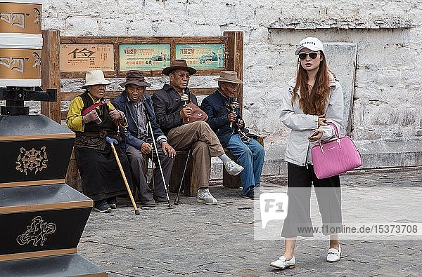 Pilgrims in front of the Jokhang Temple in Lhasa  Tibet  China  Asia