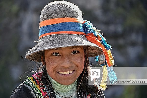 Indio girl with hat smiles  portrait  at Cusco  Peru  South America