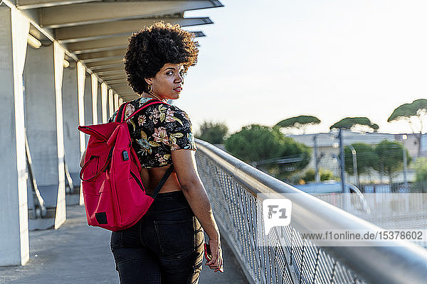 Female Afro-American with headphones and smartphone listening music