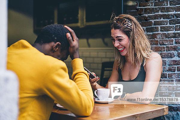 Couple having fun in a coffee shop