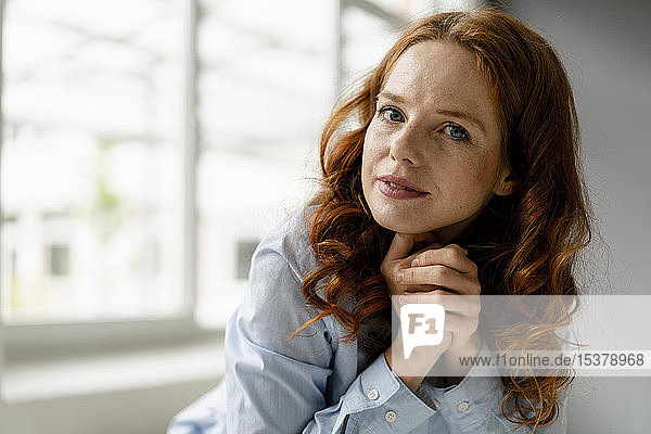 Portrait of redheaded businesswoman in a loft