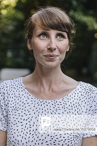 Woman standing in garden  smiling