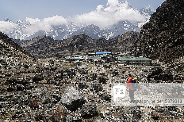 Young woman hiking in Sagarmatha National Park  Everest Base Camp trek  Nepal
