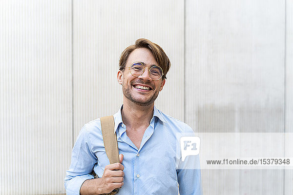 Portrait of laughing casual businessman