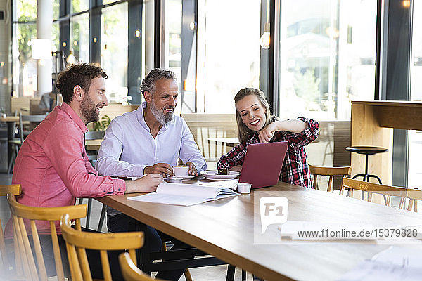 Casual business people having a meeting in a cafe