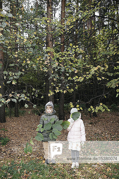 Two kids in autumnal park