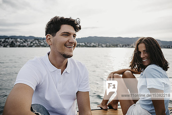 Happy young couple on a boat trip on a lake