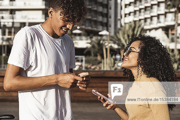 Young couple in the city  using their smartphones
