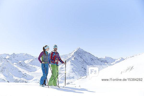 Couple of ski tourers having a break in the mountains  Kuehtai  Tyrol  Austria