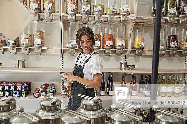 Young woman shopping in packaging-free supermarket