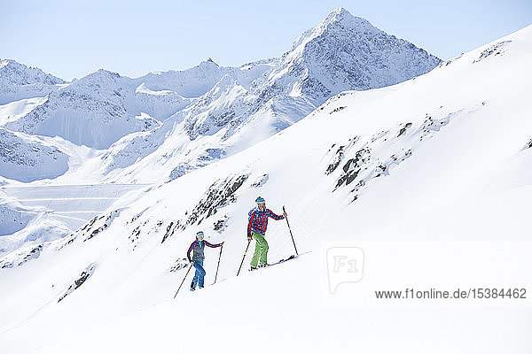 Couple ski touring in the mountains  Kuehtai  Tyrol  Austria