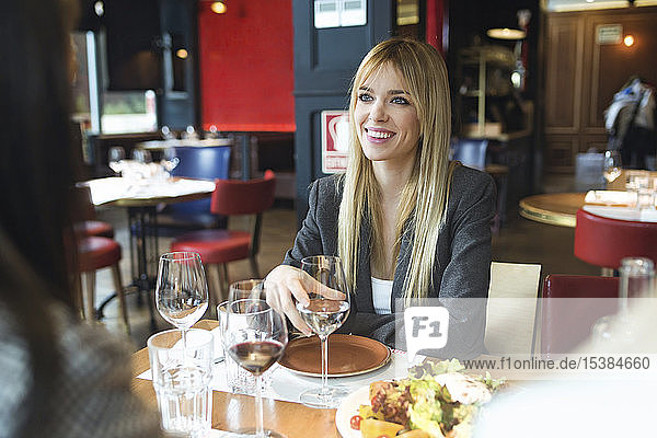 Portrait of smiling businesswoman sitting at table in a restaurant