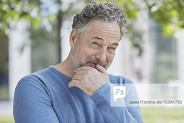 Portrait of smiling mature man in a park