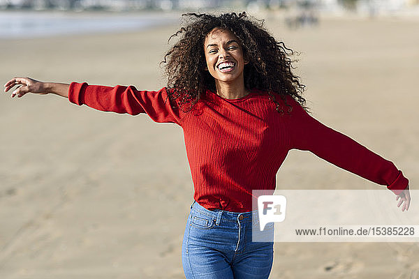 Portrait of laughing young woman on the beach