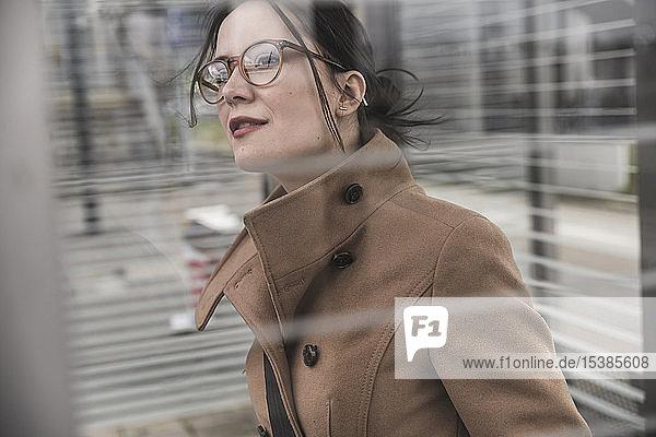 Portrait of businesswoman looking around