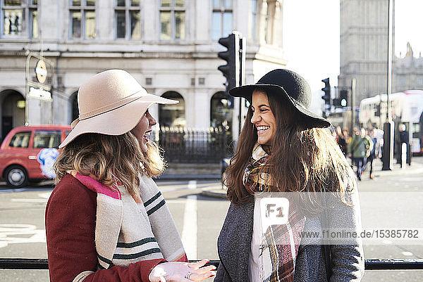 UK  London  two happy women in the city near Big Ben