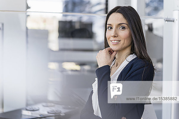 Portrait of smiling businesswoman in a modern factory