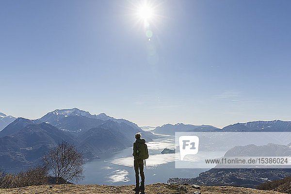 Italy  Como  Lecco  woman on a hiking trip in the mountains above Lake Como enjoying the view