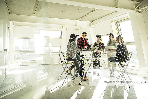 Group of creative professionals having a meeting in a bright office  discussing new solutions