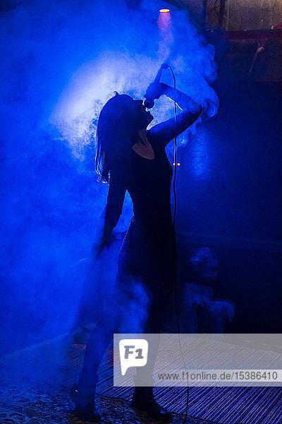 Female singer in fog